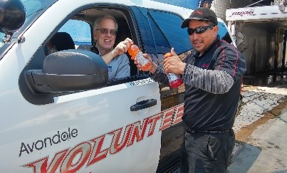 VIP handing out cold drinks to citizens